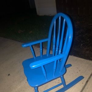 Bright blue little boy rocking chair